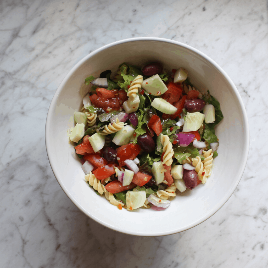 plant based pasta salad in a handmade bowl