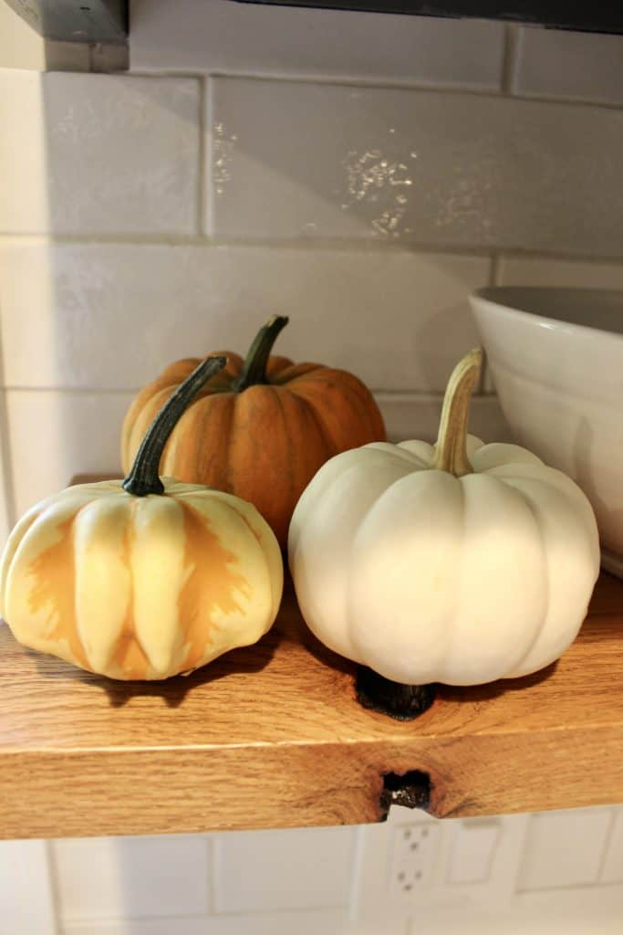 pumpkins on a shelf for sustainable decor