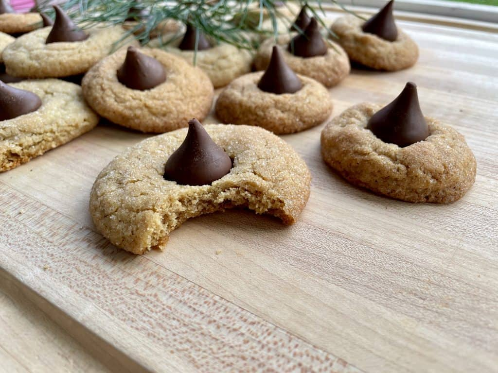 christmas cookies on cutting board