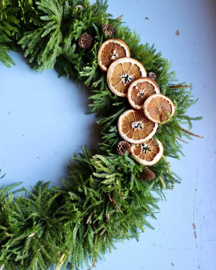 how to make a natural evergreen wreath with dried oranges
