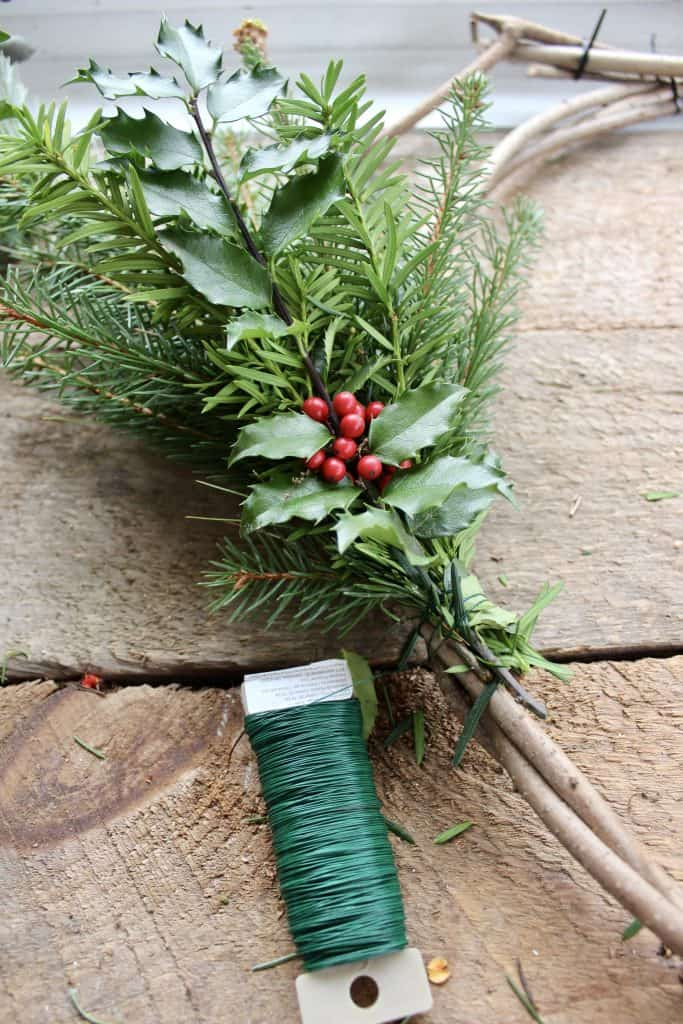 wrapping evergreens onto a wreath