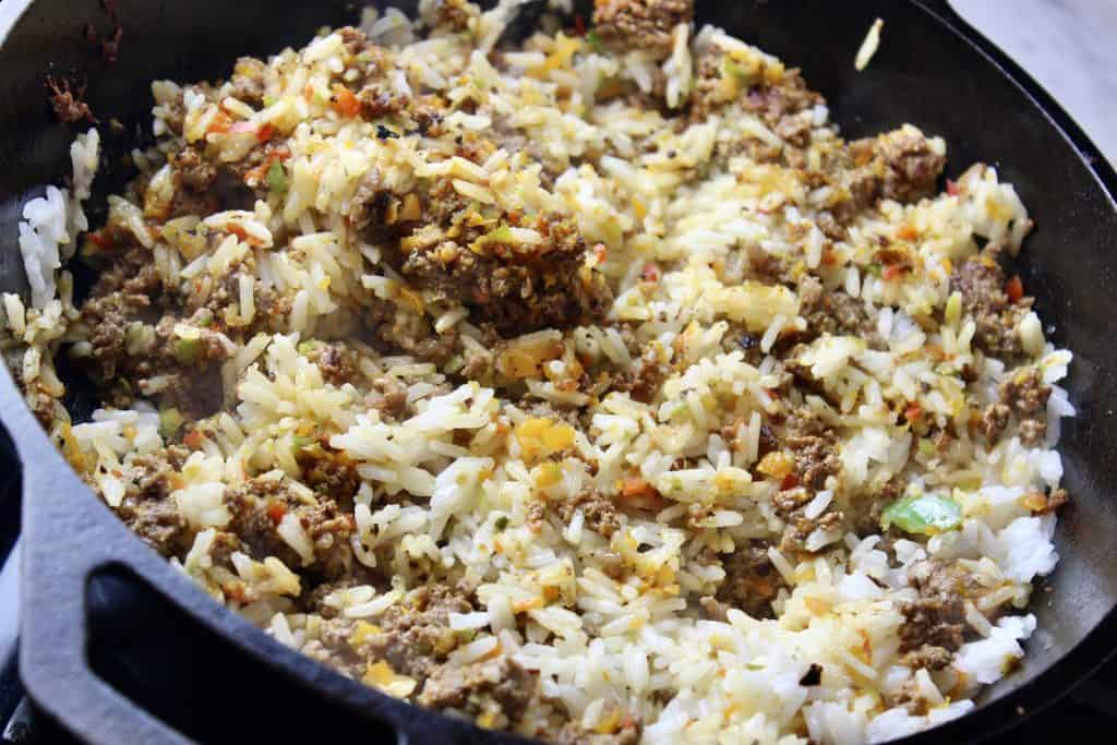 cast iron pan of rice, ground beef and peppers