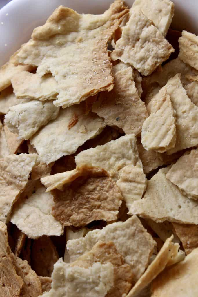 large bowl of assorted sourdough discard crackers