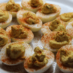 deviled eggs on a serving tray