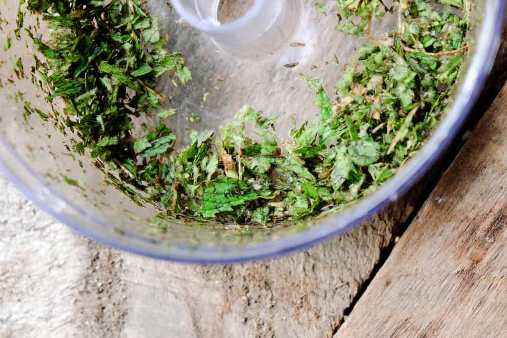 diced mint in a food processor to be added to pink himalayan salt and sugar body scrub recipe