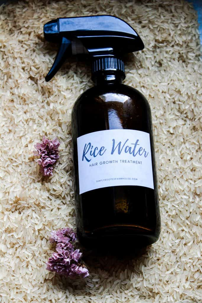spray bottle of rice water hair growth treatment