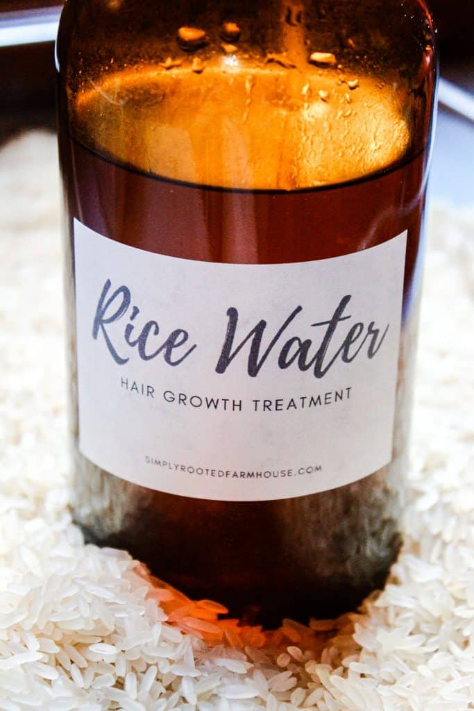 amber glass jar of rice water hair growth treatment